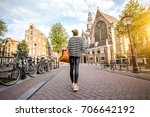 young woman tourist standing... | Shutterstock . vector #706642192