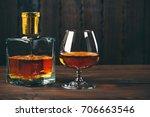 glass of brandy or cognac with... | Shutterstock . vector #706663546
