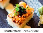 Small photo of Rice Cube Sushi topped with spicy tako (octopus)