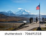mount denali looms over mckinley river valley beyond national park service eielson visitor center on clear day