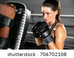 woman fighter ready to throw a... | Shutterstock . vector #706702108