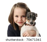 Stock photo portrait of a beautiful young girl snuggling with a cute terrier puppy dog isolated on white in 70671361