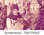 beautiful happy woman choosing... | Shutterstock . vector #706725922