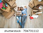 couple moving to a new home  ... | Shutterstock . vector #706731112