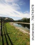 wooden fence in the alps under...   Shutterstock . vector #706743478