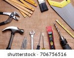 assorted work tools on wood | Shutterstock . vector #706756516