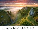 long winding rural road leading ... | Shutterstock . vector #706764376