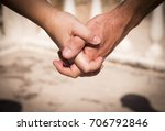 hands of two lovers intertwined | Shutterstock . vector #706792846