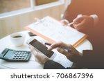 business man working in his... | Shutterstock . vector #706867396