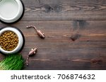 Stock photo large bowl of pet cat food with toys on wooden background top view mockup 706874632