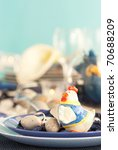 Easter table setting in blue and white tones with chicken and easter eggs. - stock photo