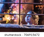 on christmas night a little... | Shutterstock . vector #706915672