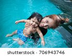 the kid and mom play together...   Shutterstock . vector #706943746