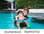 the kid and mom play together...   Shutterstock . vector #706943752