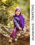 little girl in the autumn... | Shutterstock . vector #706957042