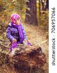 little girl in the autumn... | Shutterstock . vector #706957066