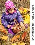 little girl in the autumn... | Shutterstock . vector #706957096