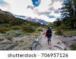 man hiking trail towards mount... | Shutterstock . vector #706957126