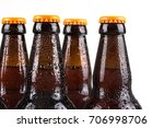 Water droplets on cold beer bottles with white background - stock photo