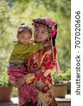 Small photo of Beautiful Tibetan costume,Tibetan mother and daughter,mother and daughter in park,mother and daughter have smile.