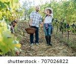 loving couple harvesting red... | Shutterstock . vector #707026822