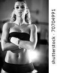 Young woman after weight training. Black and white colors. - stock photo