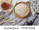 bowl full of oats with milk and ... | Shutterstock . vector #707072428
