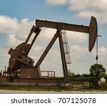 pumpjack in eagle ford shale   Shutterstock . vector #707125078