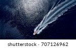 boat at sea leaving a wake | Shutterstock . vector #707126962