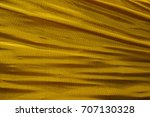 the beautiful waving gold fabric | Shutterstock . vector #707130328