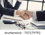 business handshake in the office | Shutterstock . vector #707179792