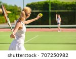 young woman playing tennis on... | Shutterstock . vector #707250982