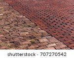 Small photo of A side-by-side comparison of granite pavers and brick pavers laid side-by-side.