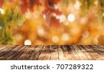 wooden table background | Shutterstock . vector #707289322
