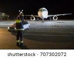 aviation marshaller meets... | Shutterstock . vector #707302072