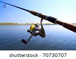 spinning and lake under blue sky - stock photo