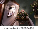 coffin and flowers | Shutterstock . vector #707366152