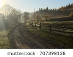 old wooden fence along the dirt ... | Shutterstock . vector #707398138