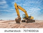 heavy earth mover with blue sky ... | Shutterstock . vector #707403016