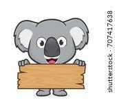 koala holding a plank of wood | Shutterstock .eps vector #707417638