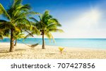 sunny paradise beach with palm... | Shutterstock . vector #707427856