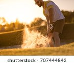 handsome guy is using a golf... | Shutterstock . vector #707444842