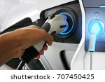 hand holding electric car... | Shutterstock . vector #707450425