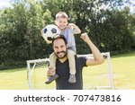 young father with his little... | Shutterstock . vector #707473816
