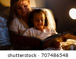 mother and child girl reading a ... | Shutterstock . vector #707486548