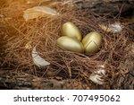 easter background golden eggs ... | Shutterstock . vector #707495062