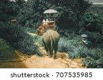 Tourists Riding Elephants...