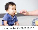 a little baby is enjoy eating... | Shutterstock . vector #707575516