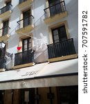 Small photo of SAN SEBASTIAN, SPAIN - APRIL 21, 2016: Decoration on the facade of the Atari Gastroteka, a gastro-bar in the old town: couple with a heart on a fishing rod.