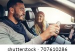 young couple on a road trip.... | Shutterstock . vector #707610286